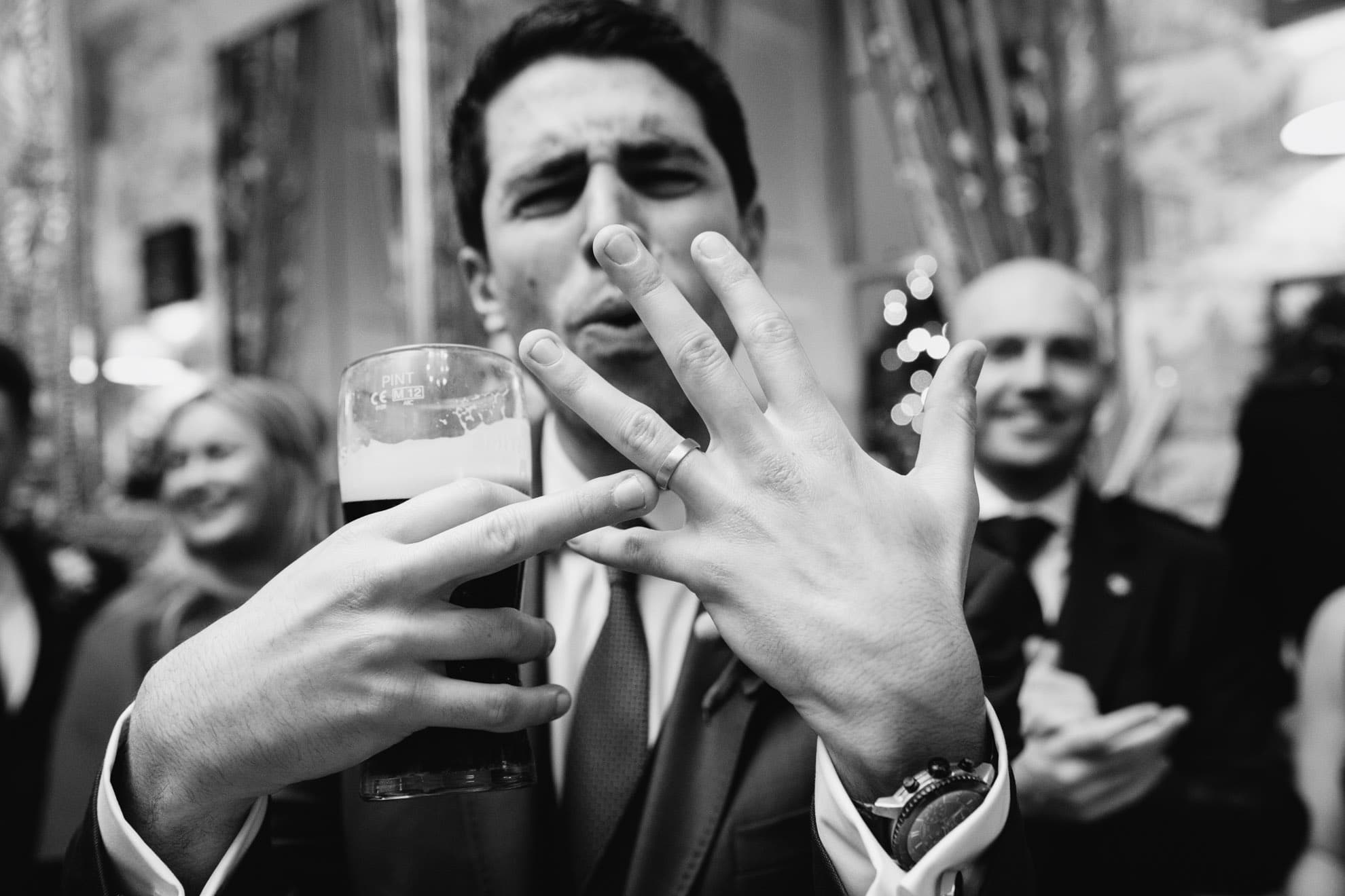 Groom showing off the wedding ring!