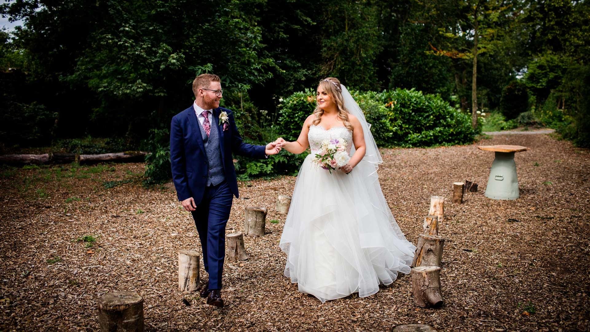 bride and groom hold hands in the keadeen hotel